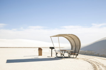 Hooded beach chair at White Sands National Monument against sky