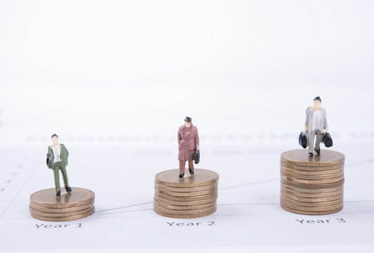 Business concept with miniature people workers on money coin pile