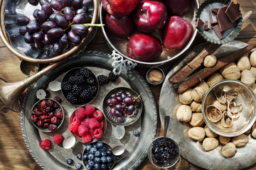 Overhead view of fruits and nuts on table