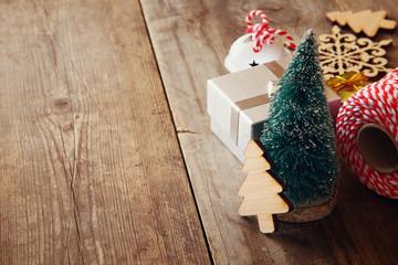 Christmas concept. Decorative christmas tree next to gift