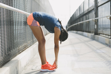 Woman exercising on footbridge