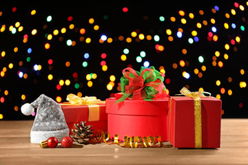 Christmas gifts on colourful lights background