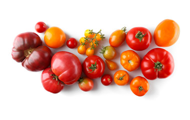 Composition of red and yellow tomatoes on white background