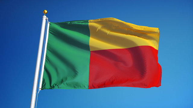 Benin flag waving against clean blue sky, close up, isolated with clipping mask alpha channel transparency, perfect for film, news, digital composition