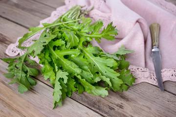 Green leaves of arugula on the napkin