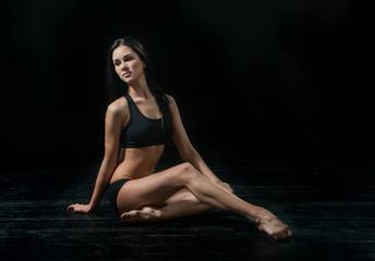 young ballet dancer dansing on white background
