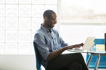 Businessman using laptop in creative office