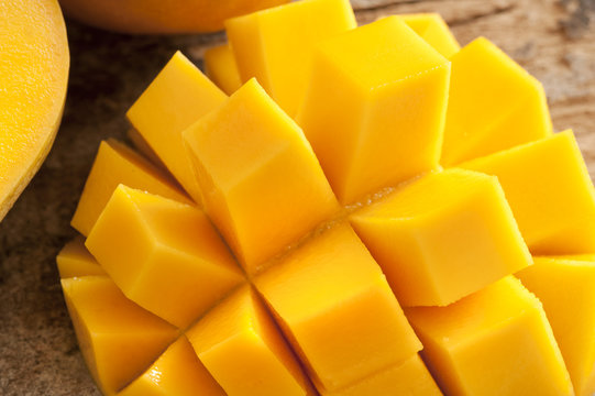 Delicious yellow mango peeled and cut into squares