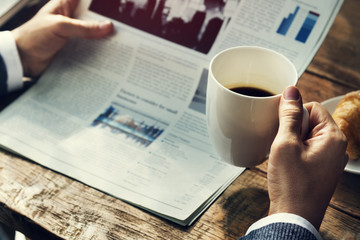 Businessman Reading Newspaper Drinking Coffee Concept