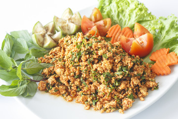 Spicy minced chicken salad isolated on white background