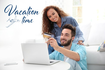 Vacation time concept. Young man and woman using credit card and laptop for online shopping