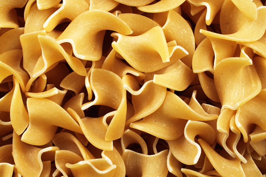 An extreme close up image of egg noodles