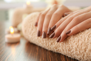 Aluminium Prints Manicure Female brown manicure on towel, closeup