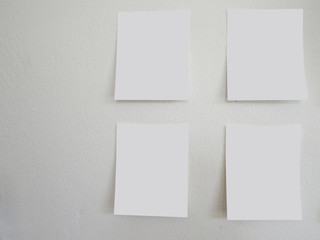 empty paper sheet on white wall and copy space