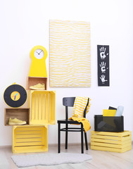 Stylish room interior with yellow furniture