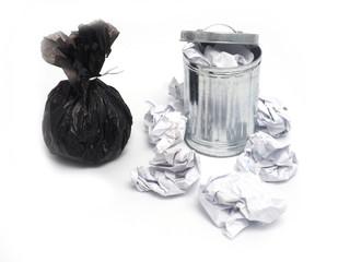 metal garbage bin and paper trash on white background