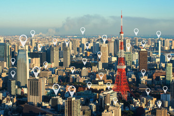 Wall Mural - Map pin flat above tokyo cityscape and network connection concep
