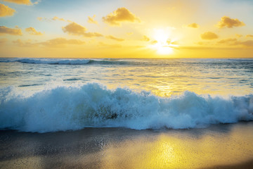 Golden sunset and a crashing wave