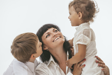 Woman smiling mother that kissing kids