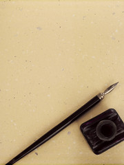 Writing pen, manuscript and ink well