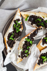 Cream cheese crostini with olives