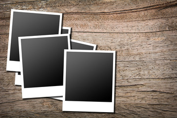 photo frames on wood background