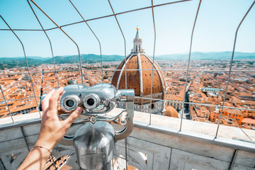 Top view from the bell tower with binocular on the dome of Santa Maria del Fiore church and old town in Florence Fototapete