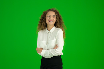 The businesswoman stand on the green background