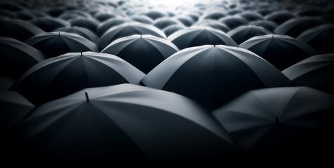 A sea of black umbrellas. Monotone society metaphor