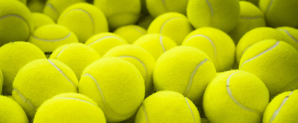 Lots of vibrant tennis balls