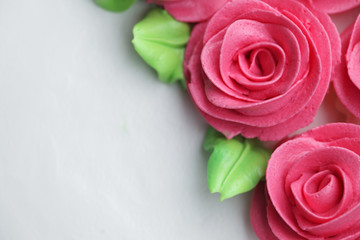 close up of rose whipped cream on cake
