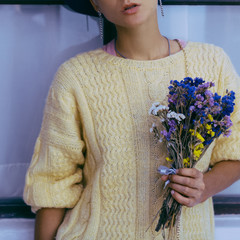 Sensual lady with bouquet fall. Knitted sweater. City Style.