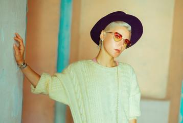 Hat is stylish detail fall season. Fashion lady in urban locatio