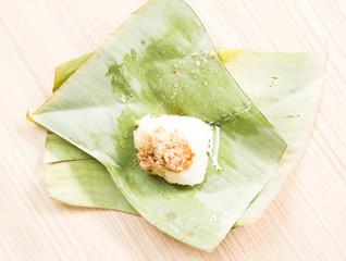 Rice with Thai custard on banana leaf