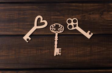 Three wooden keys