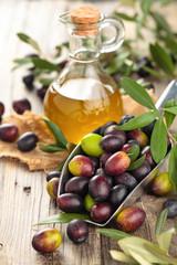Fresh olives and olive oil.