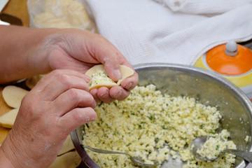 Modeling of homemade delicious vareniki, dumpling or pelmeni .
