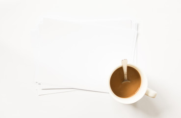 Blank stack of paper and coffee