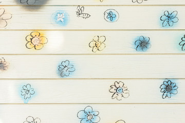 flowers drawing on wood planks