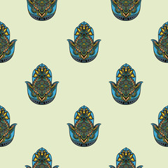 Drawing of a seamless pattern with hamsa in blue, yellow and orange colors, on light green background