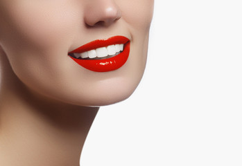 Perfect smile with white healthy teeth and red lips, dental care concept. Beautiful young woman's face fragment with natural smile. Woman smile, teeth whitening, dental care.