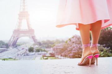 beautiful fashion woman on high heels near Eiffel tower in Paris, France