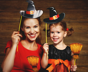 Family fun mother and child daughter celebrate Halloween in witc