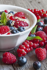 Yogurt with fresh berries in a white bowl