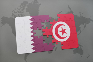 puzzle with the national flag of qatar and tunisia on a world map background.