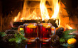 Mulled wine or hot drink, christmas decoration, fireplace