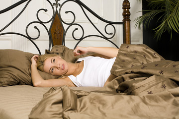 young attractive real blond woman in bed sexual pose, lifestyle people concept