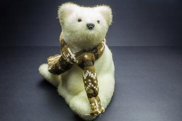 White polar bear toy alone on black background