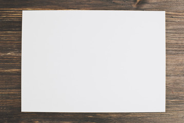 white paper on a wooden background, mock up