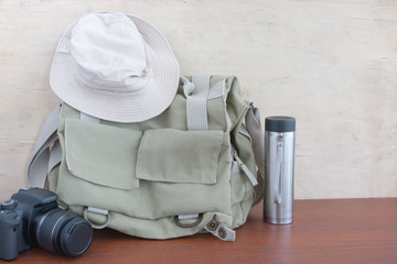 Lifestyle hiking  photo camera bag and thermos